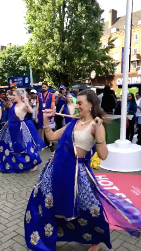 """Stills from the latest video which has surfaced on social media where foreigners can be seen dancing on Bollywood tracks. Women in electric blue ghagra-choli are seen doing dandiya on """"Chogada"""" from """"Loveyatri"""" and """"Nagara sang dhol baaje"""" from """"Goli"""