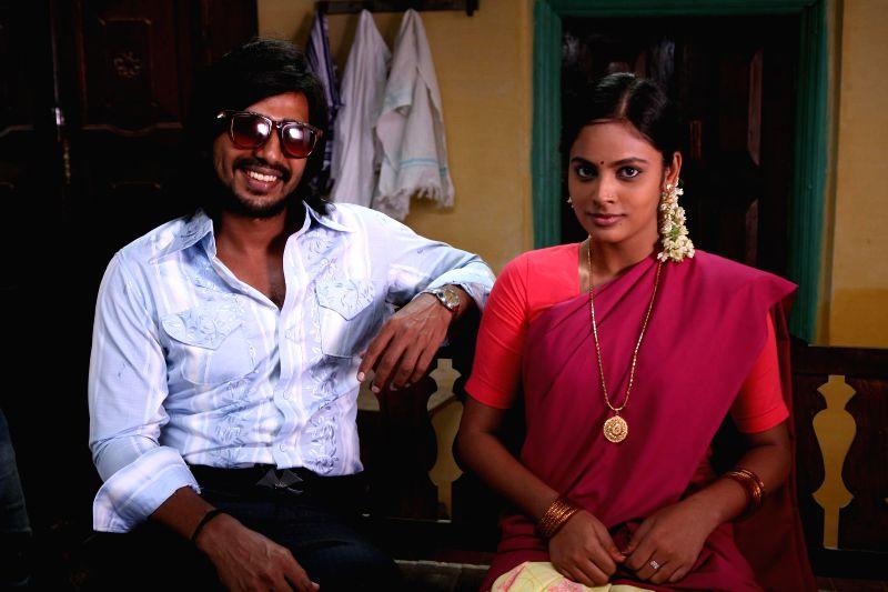 Stills from upcoming Tamil film `Mundasupatti`.