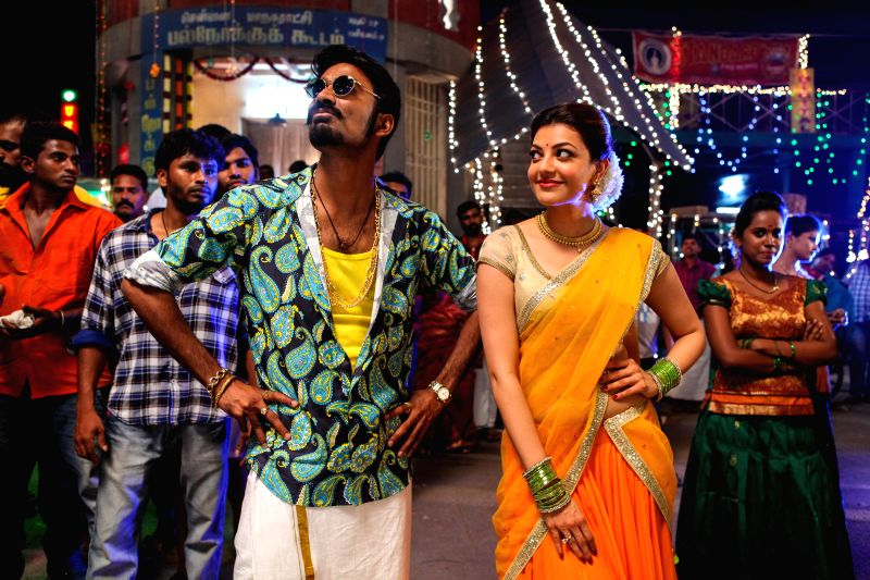 Stills of actors Dhanush and Kajal Aggarwal from the Tamil film `Maari`. - Dhanush and Kajal Aggarwal