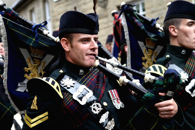 A piper takes part in the celebration of the Armed Forces Day in Stirling, Scotland, Britain, June 28, 2014. Britain's Armed Forces Day was celebrated on Saturday .