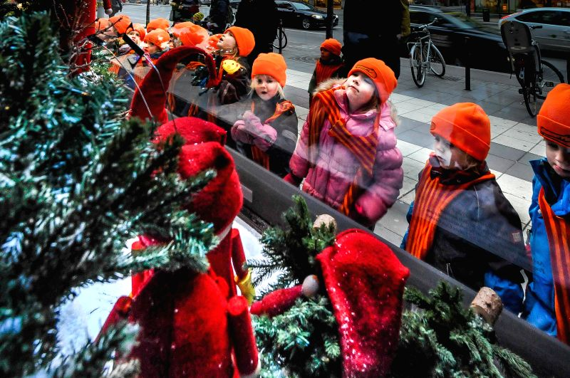 Chilldren watch the clever Christmas themed window displays at the NK Varuhuset store in Stockholm, Sweden, on Dec.3, 2014. Christmas in Stockholm is a time of bright festive lights, ice ..