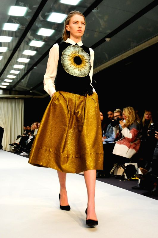 A model presents a creation by designer Valerie at Stockholm Fashion Week 2015 in Stockholm, Sweden, Jan. 27, 2015. Some 30 fashion houses present almost 900 ...