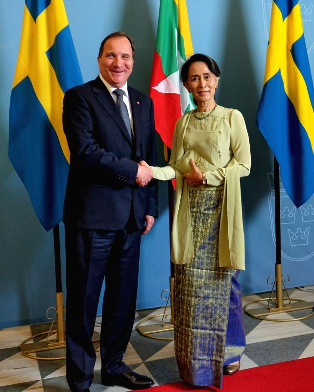 STOCKHOLM, June 12, 2017 - Swedish Prime Minister Stefan Lofven (L) shakes hands with visiting Myanmar's State Counselor Aung San Suu Kyi during their meeting at the Rosenbad government office in ... - Stefan Lofven