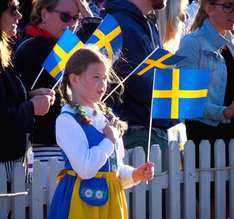 STOCKHOLM, June 6, 2017 - A Swedish girl in traditional clothes attends a celebration marking Sweden's National Day at Skansen Park in Stockholm, capital of Sweden, on June 6, 2017. Swedish Prime ... - Stefan Lofven