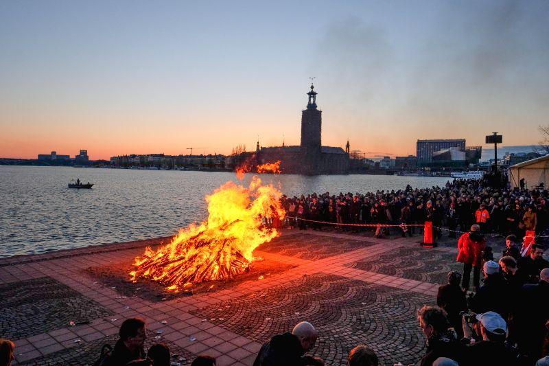 STOCKHOLM, May 1, 2017 - Hundreds of Swedes gather round a bonfire on the island of Riddarholmen to celebrate Valborg in Stockholm, capital of Sweden, on April 30, 2017.