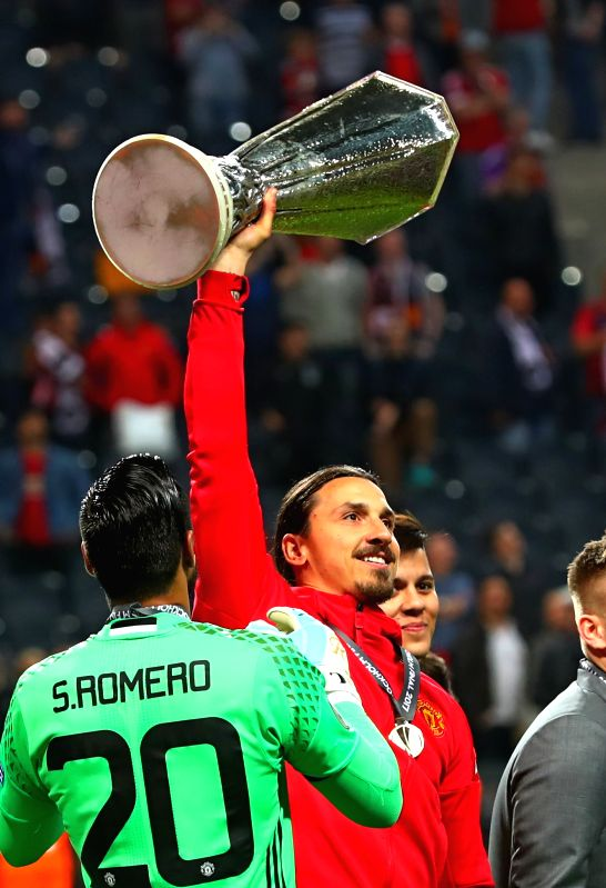 STOCKHOLM, May 25, 2017 - Manchester United's Zlatan Ibrahimovic (2nd L) celebrates with the trophy after winning the UEFA Europa League Final match between Manchester United and Ajax Amsterdam at ...