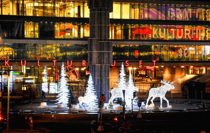 Reindeer sculptures formed with lights shine in front of Kulturhuset at Sergeltorg, Stockholm's central square, Sweden, on Dec.3, 2014. Christmas in Stockholm is a time of bright festive ..