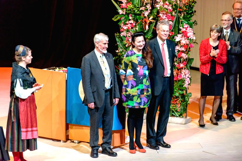 Stockholm (Sweden): The 2014 Nobel laureates for Physiology or Medicine, John O'Keefe (2nd L), May-Britt Moser (3rd L) and Edvard Moser (4th L) are seen prior to giving their lectures at the Swedish .