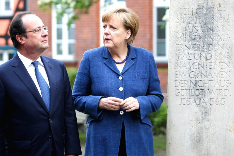 STRALSUND (GERMANY), May 10, 2014 German Chancellor Angela Merkel (R) and visiting French President Francois Hollande view a monument in a cloister in the Baltic sea town of Stralsund, ...