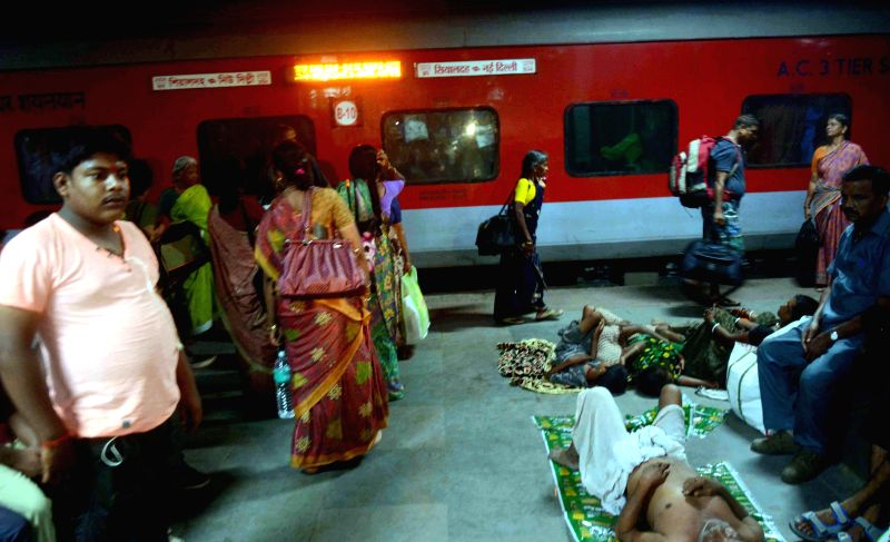 Stranded passengers of Bhubaneshwar-New Delhi Rajdhani Express at a railway station as rail traffic was disrupted between Ismailpur and Rafiganj section of Bihar where Maoists triggered an explosion .
