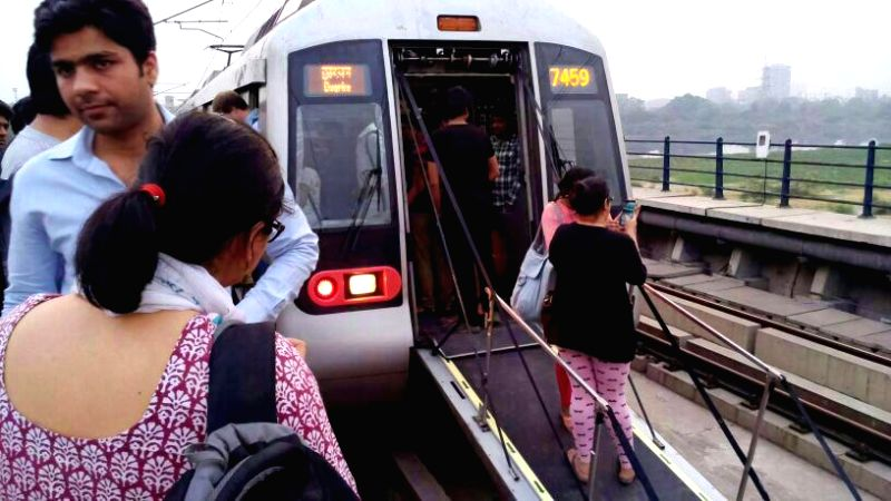 Stranded passengers of Delhi Metro who had a harrowing experience after an overhead electric cable broke down on the Yamuna Bank-Indraprastha station stretch in New Delhi on May 7, 2014.