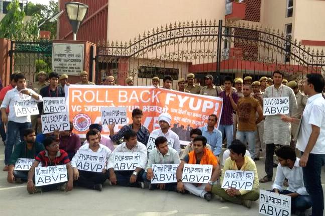 Students affiliated to Akhil Bharatiya Vidyarthi Parishad (ABVP) demonstrate against FYUP  outside UGC in New Delhi on June 19, 2014.