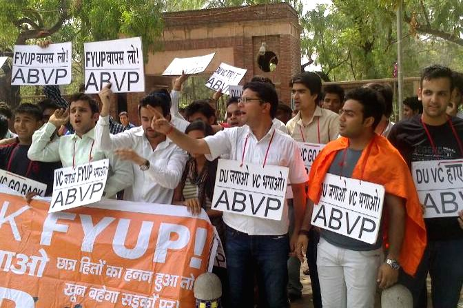 Students affiliated to Akhil Bharatiya Vidyarthi Parishad (ABVP) demonstrate against FYUP  outside DU in New Delhi on June 19, 2014.