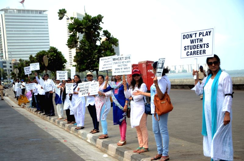 Students and their parents form a human chain at Marine Drive of Mumbai to press for bringing back of Maharashtra Common Entrance Examinations (MH-CET) on May 17, 2016.