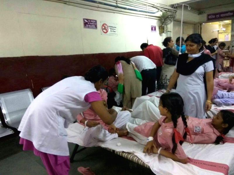Students being treat at a hospital as they fell ill after a gas leak near a school in Delhi on May 6, 2017. Over 100 students were admitted to hospitals after a gas leak near a school in ...