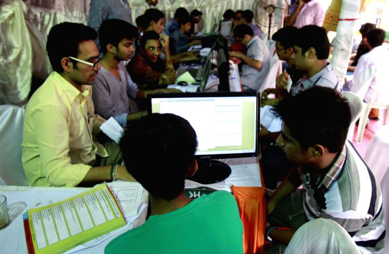 Students busy filling online forms for college admissions in Mumbai on June 19, 2014.