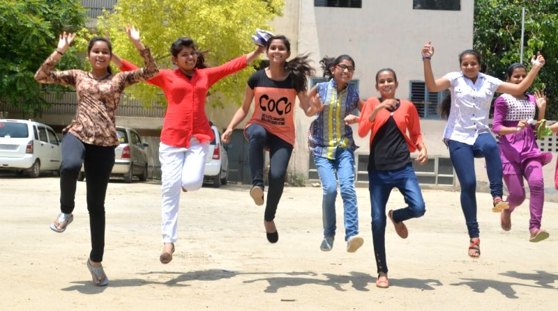 Students celebrate after CBSE Class X results were declared, in Ghaziabad on June 3, 2017.