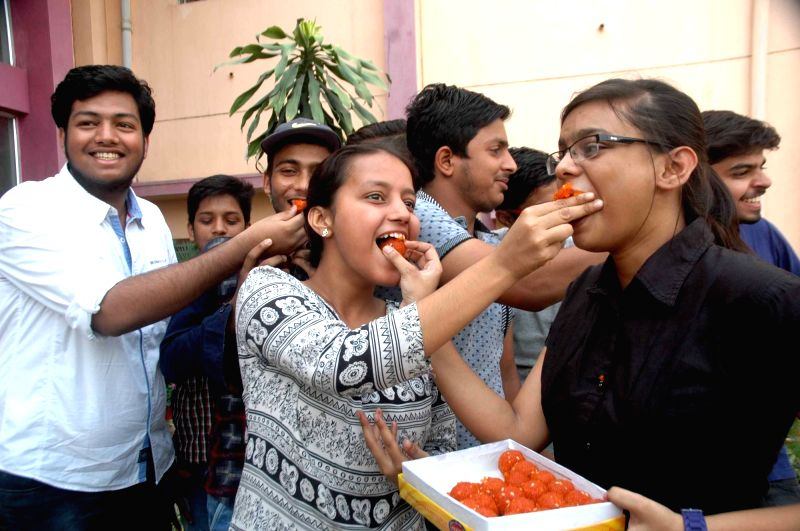 Students celebrate after CBSE Class X results were declared in Ranchi on June 3, 2017.