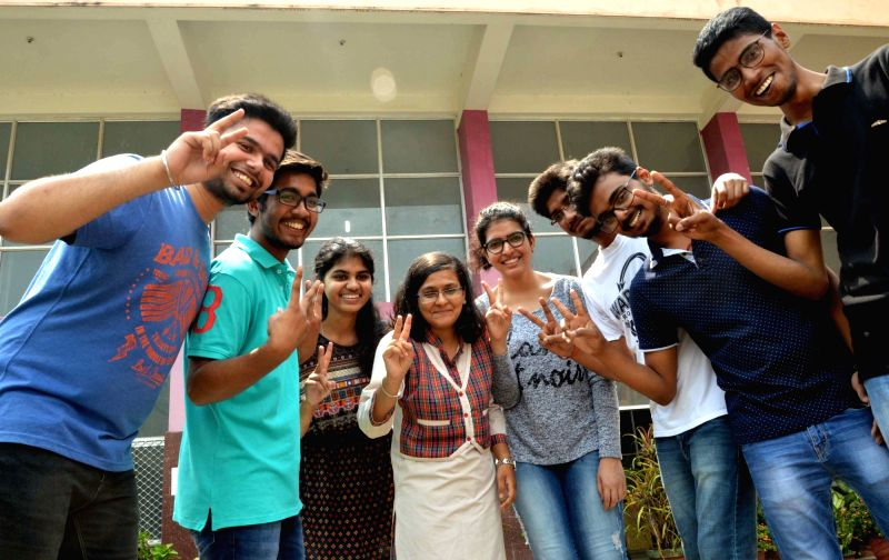 Students celebrate after Class 12 CBSE exams results were declared, in Patna on May 28, 2017.