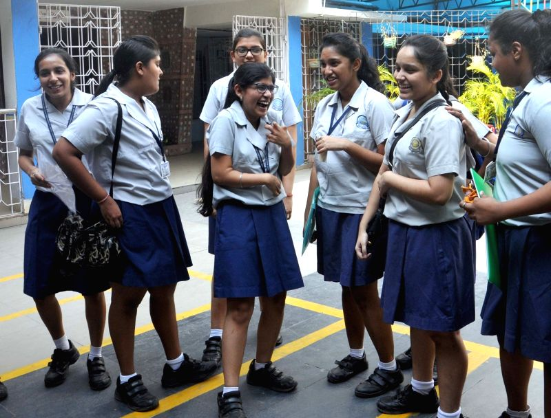 Students celebrate after Class 12 CBSE exams results were declared, in Kolkata on May 28, 2017.