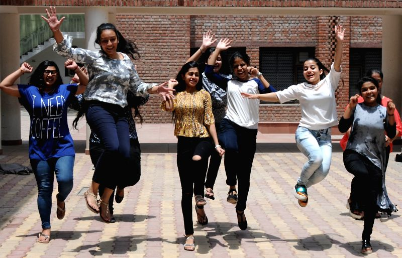 Students celebrate after Class 12 CBSE exams results were declared, in New Delhi on May 28, 2017.