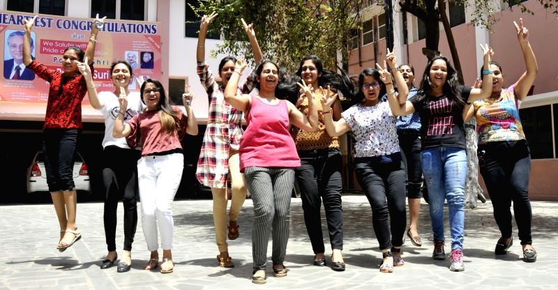 Students celebrate after Class 12 CBSE exams results were declared, in Amritsar on May 28, 2017.
