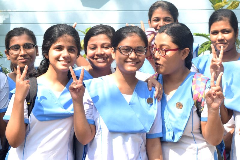 Students celebrate after declaration of class 12 results by West Bengal Council of Higher Secondary Education in Kolkata, on June 8, 2018.