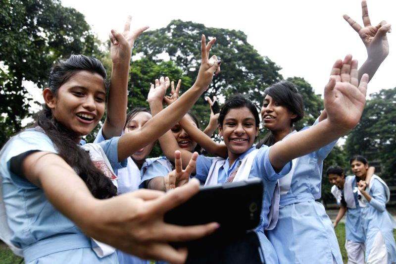 Students celebrate after declaration of Higher Secondary results in Dhaka, Bangladesh on Aug 13, 2014.