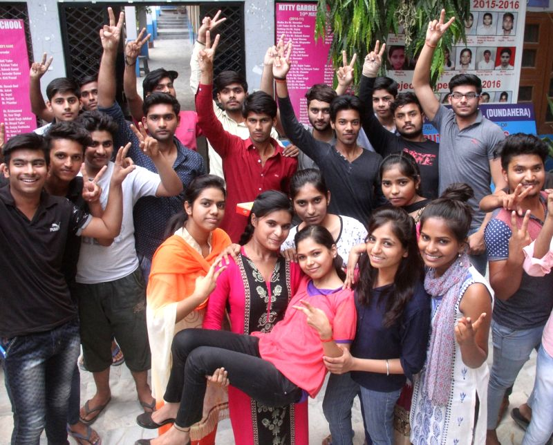 Students celebrate after declaration of Higher Secondary results by Haryana Board in Gurugram on May 18, 2017.