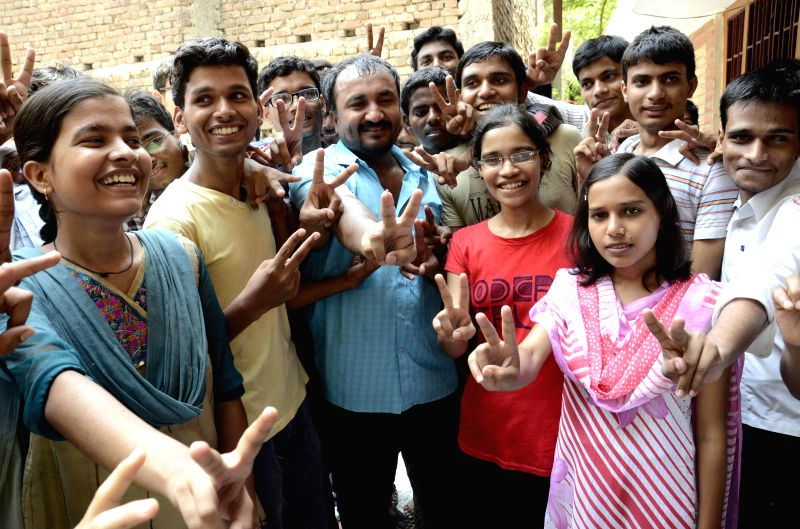 Students celebrate after declaration of IIT results at an engineering coaching centre in Patna on June 19, 2014.