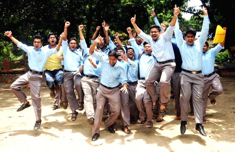 Students celebrate after declaration of results of higher secondary exams conducted by West Bengal Council for Higher Secondary Education (WBCHSE) in Kolkata on May 30, 2017.