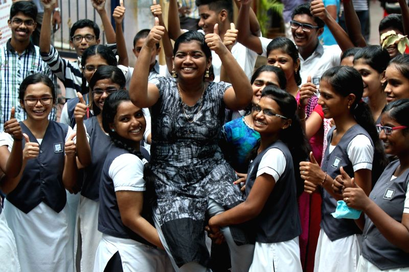 Students celebrate after their results to Tamil Nadu Higher Secondary Certificate (HSC) Class XII examinations were announced, in Chennai on May 16, 2018.