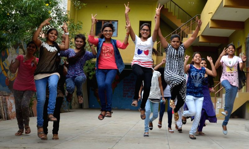 Students celebrate after Uttar Pradesh Board exam results were declared in Agra on June 9, 2017.