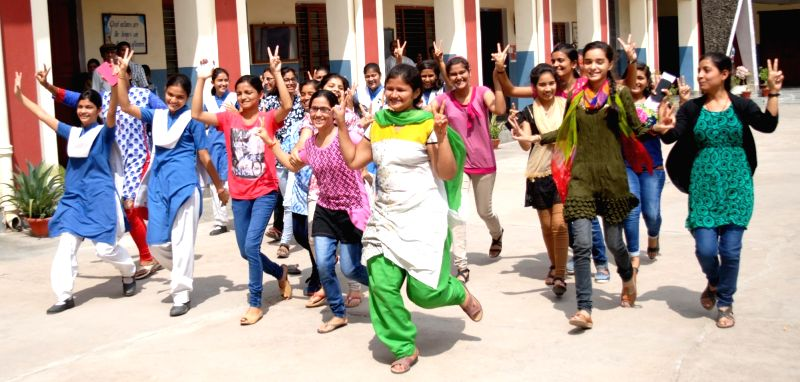 Students celebrate after Uttar Pradesh Board exam results were declared in Allahabad on June 9, 2017.