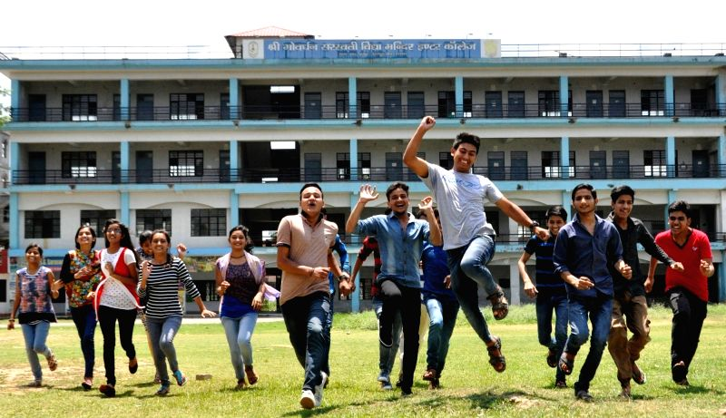 Students celebrate after Uttarakhand Board examinations results were declared in Dehradun, on May 30, 2017.