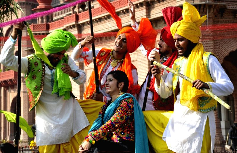 Students celebrate on the eve of Lohri in Amritsar, on Jan 12, 2018.