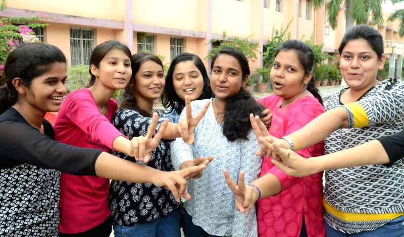 Students celebrate their success as CBSE announced Class 12 results in Patna on May 21, 2016.