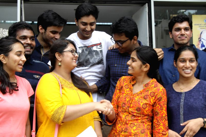 Students celebrate their success as CBSE announced Class 12 results in Bengaluru on May 21, 2016.