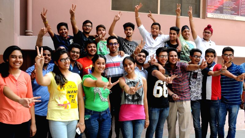 Students celebrate their success as CBSE announced Class 10 results in Amritsar on May 28, 2016.