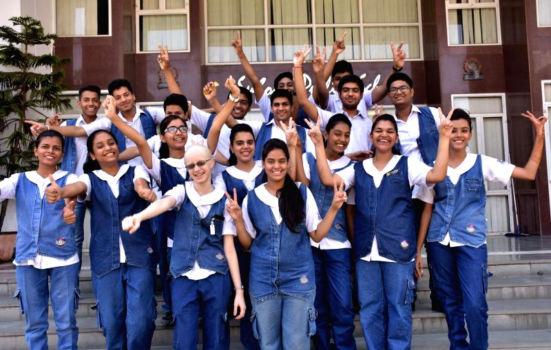 Students celebrate their success as CBSE announced Class 10 results in Jaipur on May 28, 2016.
