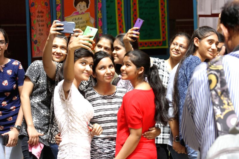 Students celebrate their success as CBSE announced Class 10 results in New Delhi on May 28, 2016.