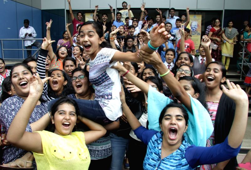 Students celebrate their success as CBSE announced Class 10 results in Bengaluru on May 28, 2016.