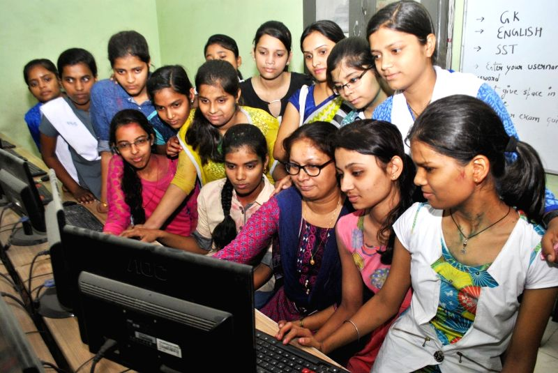 Students check their results online in Allahabad, on May 15, 2016. Uttar Pradesh Madhyamik Shiksha Parishad declared class X results.