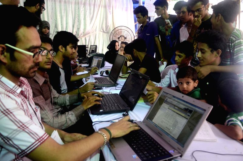 Students checking results of Maharashtra State SSC board examination in Mumbai on June 17, 2014.