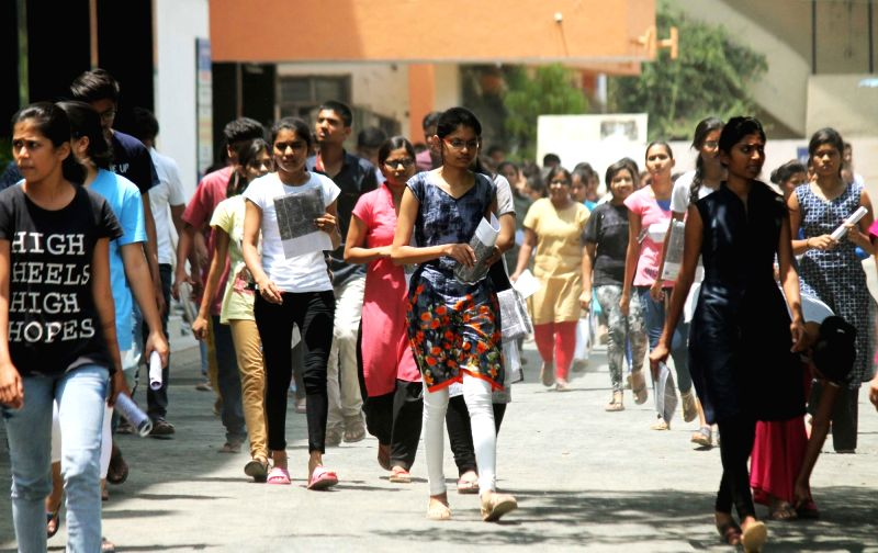 Students come out of an exam centre after appearing in CAT exam