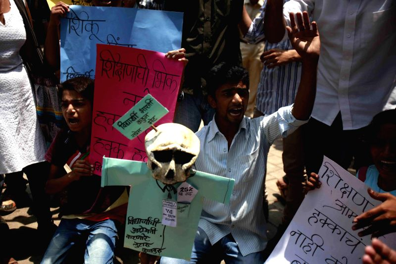 Students demonstrate against fee hike of Mumbai University in Mumbai on April 28, 2014.