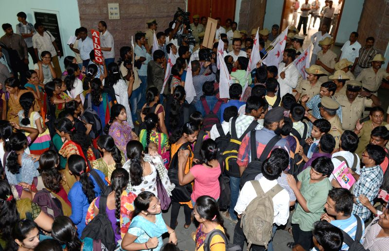 Students demonstrate against hike in examination fees of Bangalore University at Central College in Bangalore on April 25, 2014.
