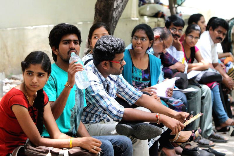 Students during 2014 Engineering, Agriculture and Medical Common Entrance Test (EAMCET) counselling session at Jawaharlal Nehru Technological University in Hyderabad on Aug 14, 2014.