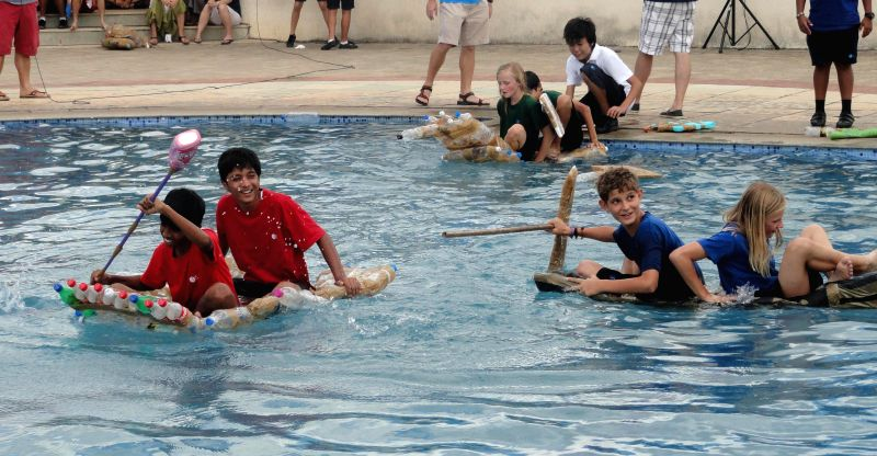 Students enjoy themselves during 'Recycled Regatta'  an event organised at an international school in Bangalore on July 8, 2014.