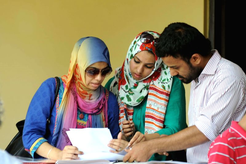 Students fill-up admission forms for admissions in under-graduate courses at Miranda House College in New Delhi on July 4, 2014.